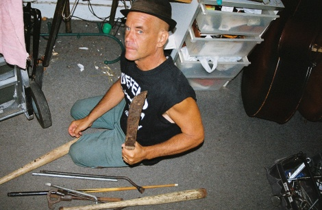 My father in his home, displaying the weapons he hides throughout the Far Rockaway bungalow.