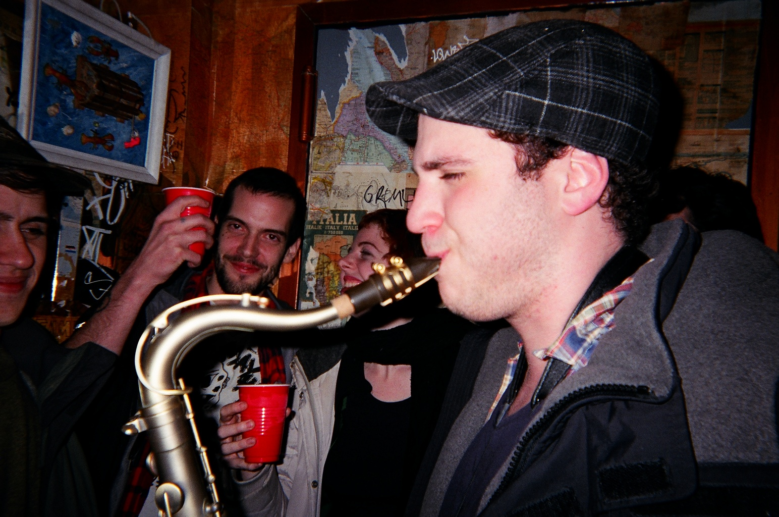 "Ray hired a saxophone player off Craigslist for his birthday party. Unfortunately, the clown he hired for ""$25 and an open bar"" did not show up. Last days of Speakeasy. RIP Rot Gut."