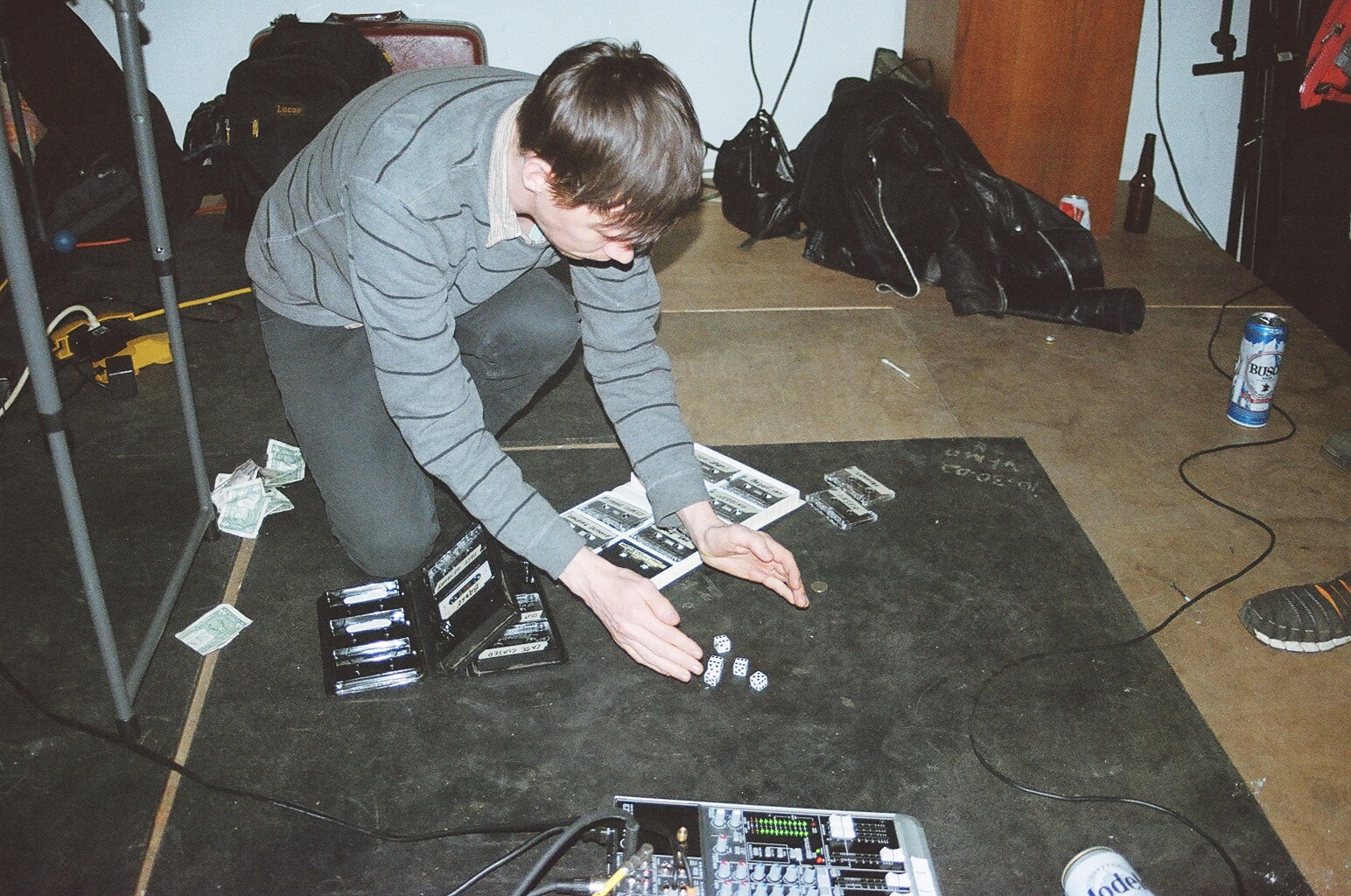 Noah playing dice while also playing a set with Form A Log.