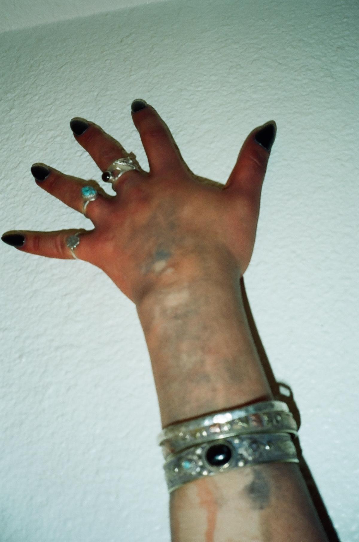 Fake blood, fake nails, really dirty, Tempe.